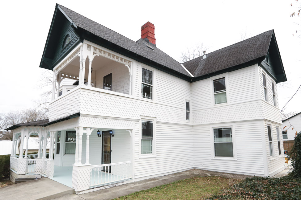 Cedar and cypress siding installation image on an 1800s Queen Anne Victorian house in Tennessee
